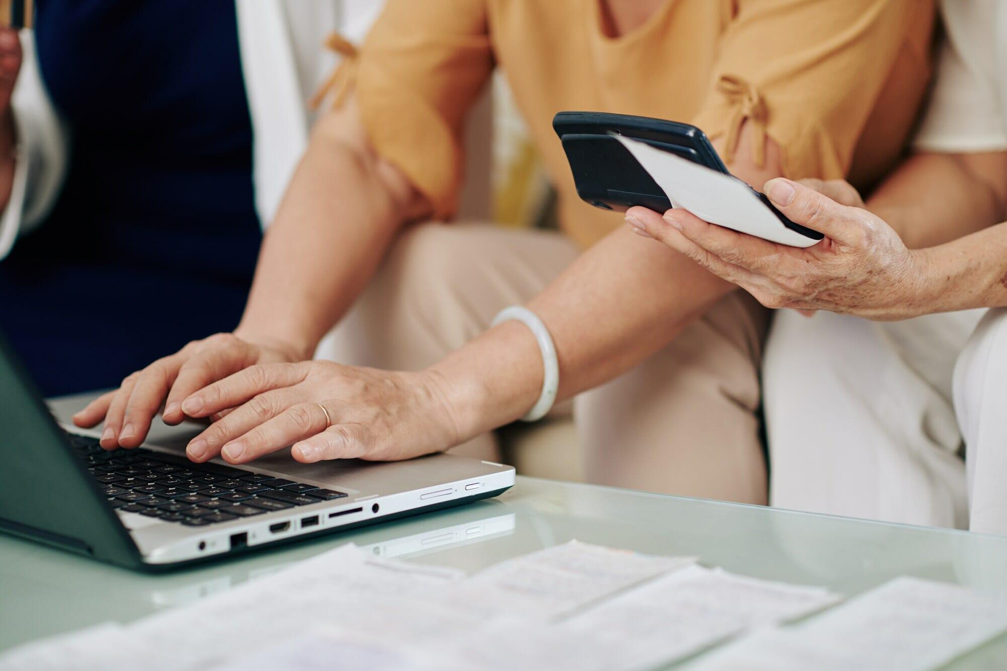 Senior women paying bills online